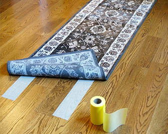 Rug grippers can be used to reduce fall risks by securing loose rugs in place.